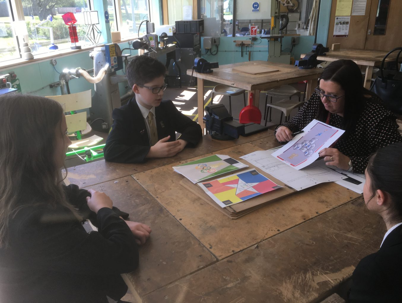 Claire helps pupils design paving for New Sports Hall